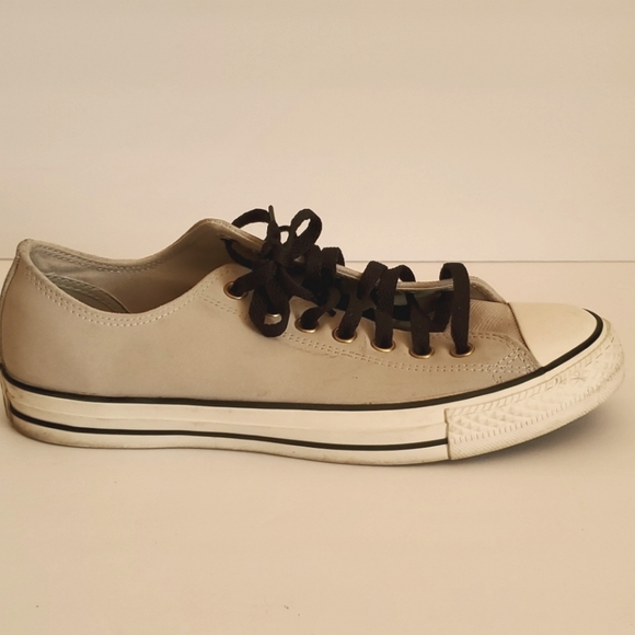 Converse gray leather shoes.